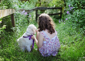 puppy and little girl