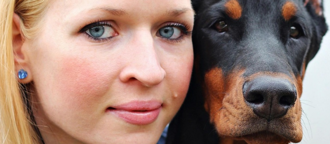 dobermann and owner